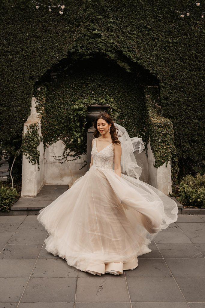 bride twirling her dress