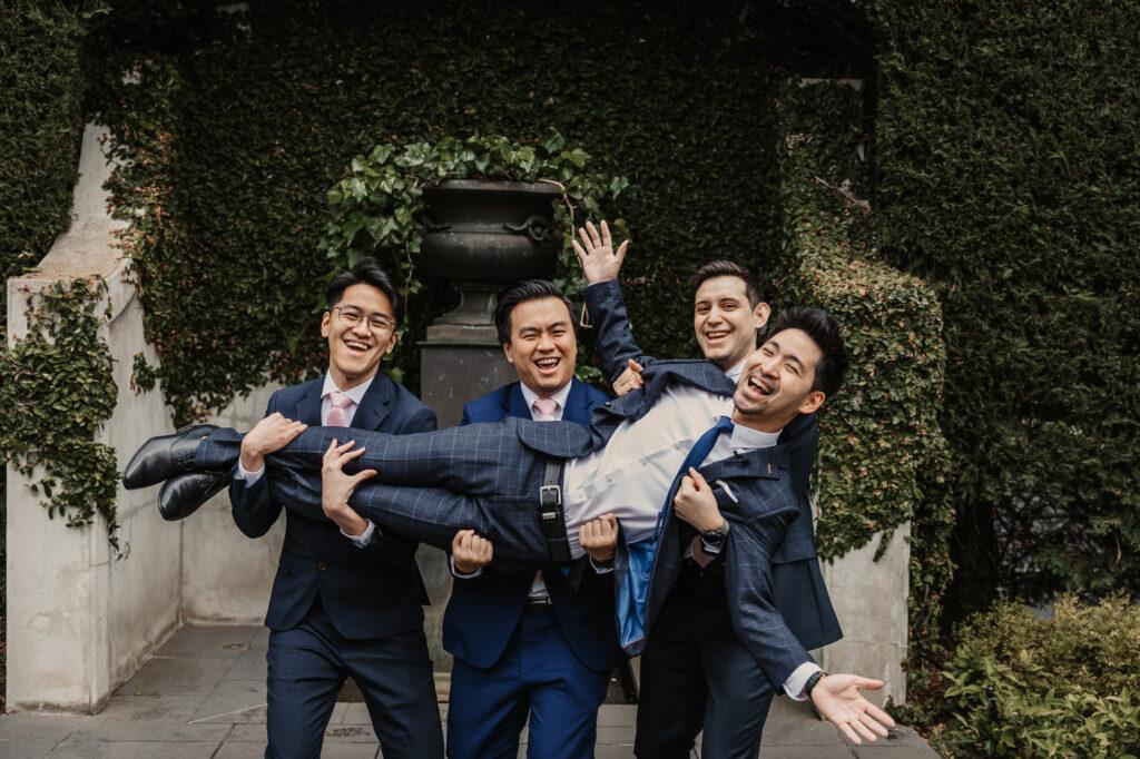 groomsmen fooling around