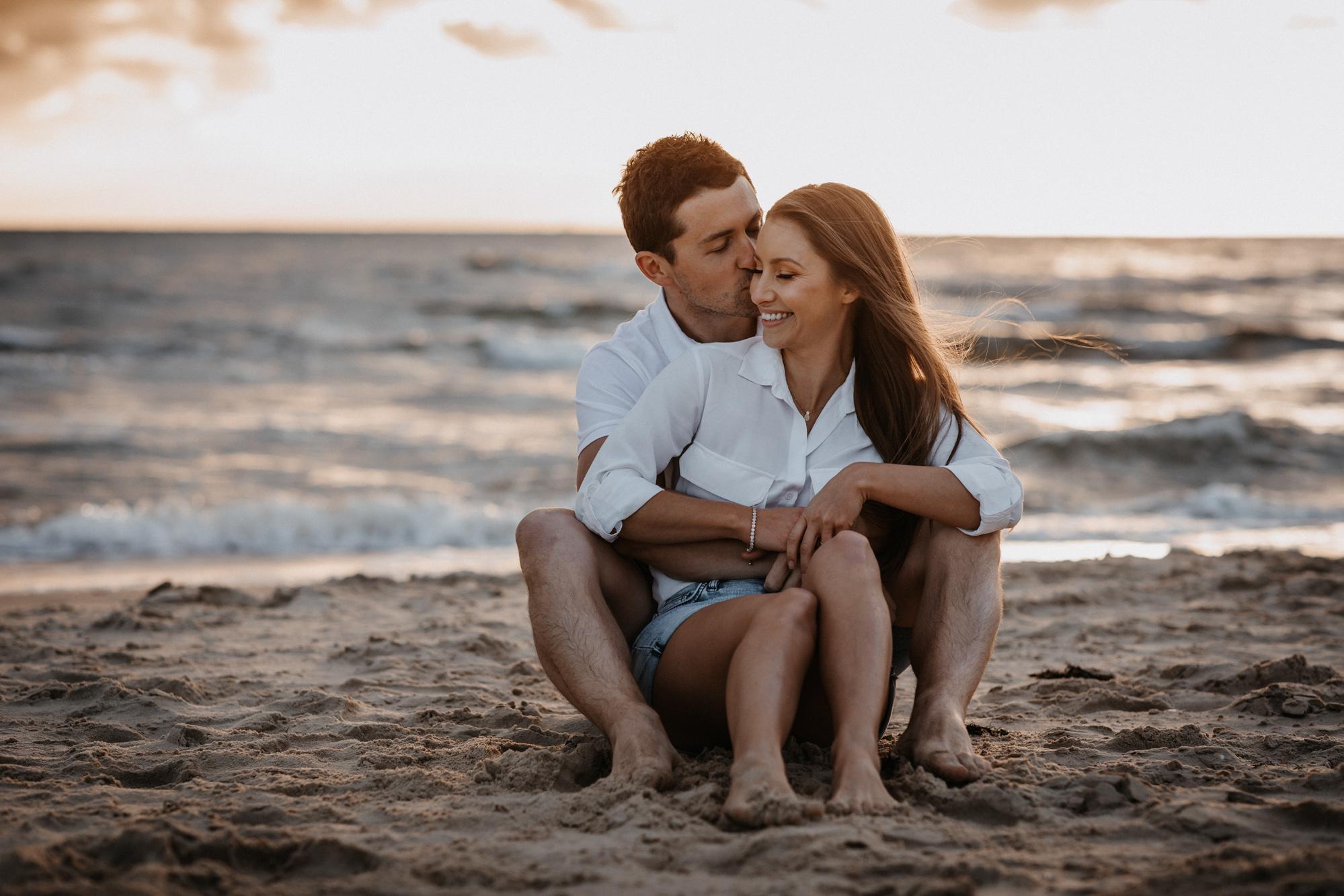 couple get close at Brighton beach, melbourne