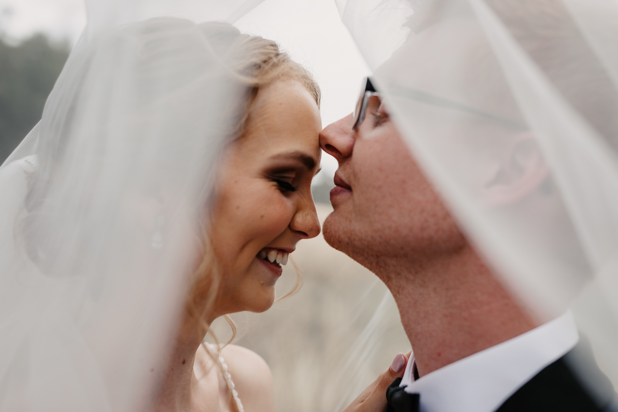 Husband and wife under the veil on a location shoot Wagga Wagga