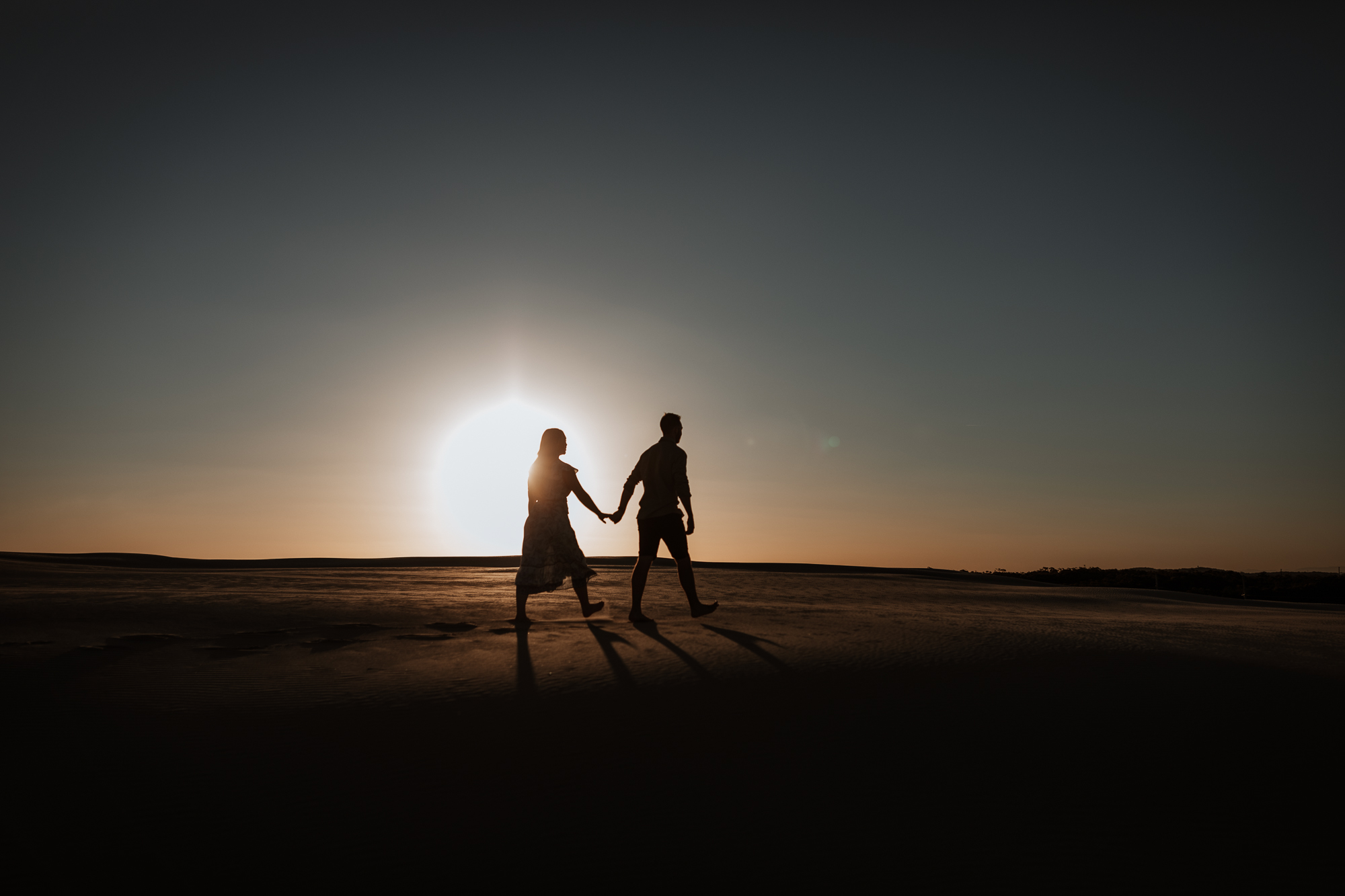 Engagement Session on the sand dunes during sunset
